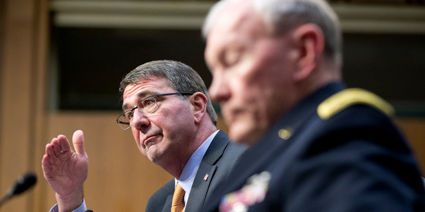 Defense Secretary Ash Carter, left, accompanied by Joint Chiefs Chairman Gen. Martin Dempsey. Photo / AP