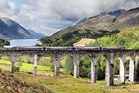 The Glasgow to Mallaig train crosses the Glenfinnan Viaduct in the Highlands of Scotland as part of its journey. The bridge, constructed in 1898, features in the film 'Harry Potter and the Chamber of Secrets'. Photo / Supplied