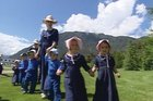 Children dressed in Cooperite clothing walk at Gloriavale, home of the Cooperite religious sect. Photo / TVNZ