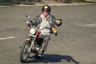 Ewan McDonald rides with Scooter Roo Tours through Town of 1770. Photo / Ewan McDonald
