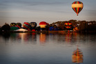 The hot air balloons take to the skies over Waikato. Photo / Christine Cornege