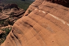 A drone films Polish cyclist Michal Kollbek as he rides the world's most dangerous trail - the White Line in Sedona, Arizona.
