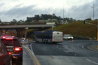The bus was snapped going the wrong way around a busy roundabout. Photo / Jono Norton