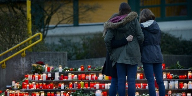 Students gather at a memorial of flowers and candles in front of the Joseph-Koenig-Gymnasium secondary school. Photo / AP