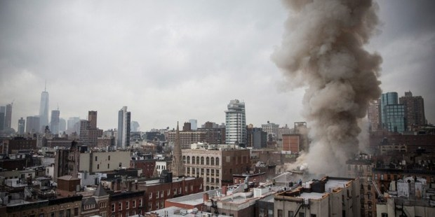 Smoke rises from a burning building after an explosion on 2nd Avenue in New York City. Photo / AFP