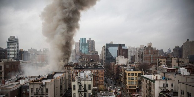 Smoke rises from a burning building in New York City. The seven alarm fire drew firefighters from across the city. Photo / AFP