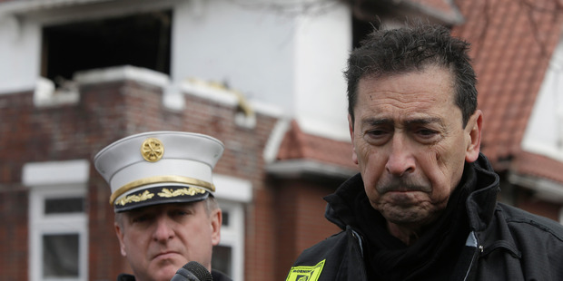 New York's Fire Commissioner Daniel Nigro, right, speaks to reporters during a news conference in front of the scene of a fatal fire in the Brooklyn borough of New York. Photo / AP