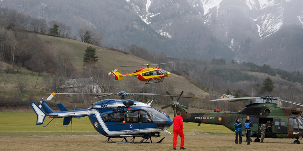 A helicopter takes off from Seyne-les-Alpes, French Alps as search-and-rescue teams struggle to reach the remote, snow-covered crash site of Germanwings passenger plane. Photo / AP