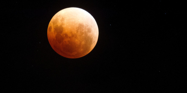 Weather permitting, a total lunar eclipse will be visible throughout NZ late Saturday night and early Sunday morning of Easter weekend. Photo / NZME.