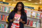 Actress Octavia Spencer poses with her new book at The Grove, before meeting fans who said the Oscar winner acted like