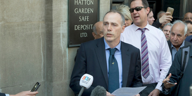 Detective Chief Inspector Paul Johnson of the Metropolitan police Flying Squad speaks to media outside the Hatton Garden Safe Deposit. Photo / AP