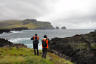Volunteer builders who restore historic buildings for the Department of Conservation in the Auckland Islands.