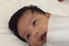 Baby Seth goes from a bundle of energy to a sleeping cherub in less than a minute. Photo / YouTube / Nathan Dailo