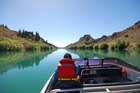 Travel on the Clutha River by boat, just don't swim in it. Photo / Hannah Cameron