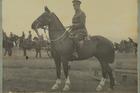 Major Clyde McGilp cut an imposing figure on horseback.