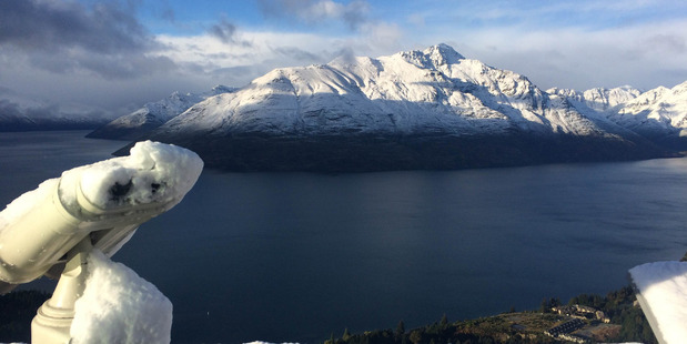 A view of a snow-capped Cecil Peak across a chilly Lake Wakatipu. Photo / Mark Blake/Skyline Queenstown