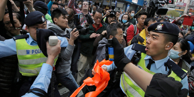 Police officers try to control the confrontation between activists demonstrating against the mainland Chinese shoppers and local villagers at a suburban district of Yuen Long in Hong Kong. Photo / AP