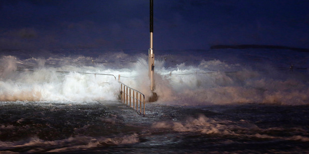 Huge waves crash over swimming baths at Avalon Beach in Sydney. Photo / AP