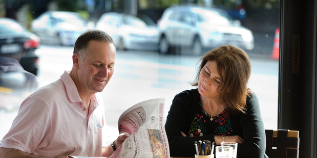 New Zealand Prime Minister and leader of the National Party, John Key, with his wife Bronagh, at their local coffee shop the morning after the general election. File photo / Brett Phibbs