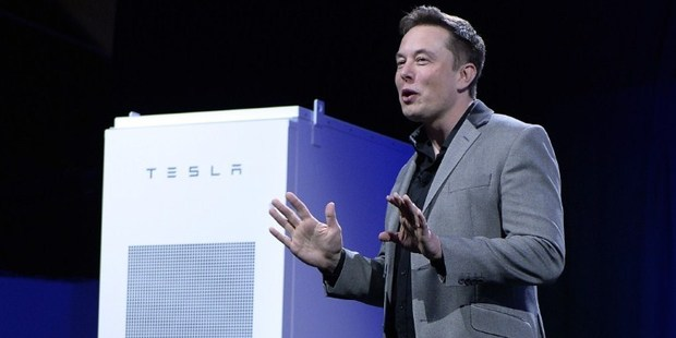Tesla CEO Elon Musk unveiling a a suite of batteries for homes, businesses, and utilities at the Tesla Design Studio. Photo: AFP.