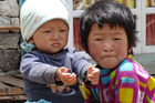 Local kids in the Everest region of Nepal try to charm trekkers out of chocolate. Photo / Winston Aldworth