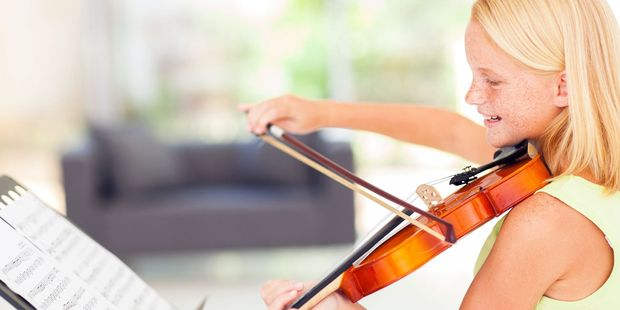 Researchers looked at brain development in children who play musical instruments. Photo / 123RF