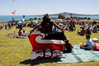 A man adjusts the Tino Rangatiratanga Maori Flag that he wore as a skirt at the Waitangi Day celebrations at Bastion Point in Auckland. Photo / Greg Bowker