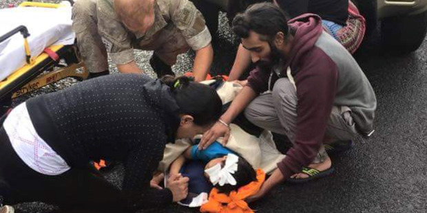 Harman Singh (right) took the exceptional step of removing his turban in public so he could use it to cradle the bleeding head of a 5-year-old  boy hit by a car. Photo / Supplied
