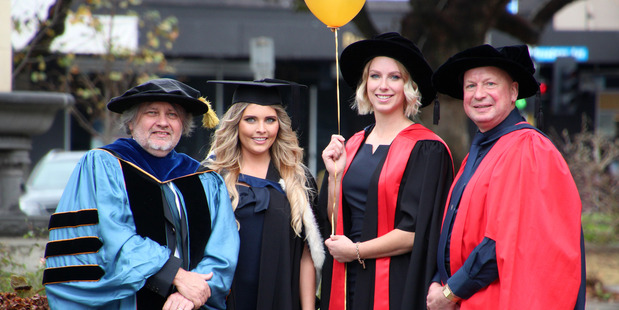 Distinguished Professor Peter Schwerdtfeger and daughter Laura Schwerdtfeger with Dr Mirjam Guesgen and her father Professor Hans Guesgen at graduation at Massey University this week. Photo / Supplied