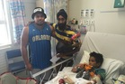 Emotional reunion: Harman Singh with Elijiah Pahia and six-year-old Daejon Pahia.