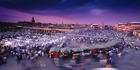 The bustling market at dusk in Djemaa el Fna, Marrakech. Photo / Getty Images