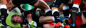 Sharks player Renaldo Bothma lays the ball back during the Super 15 rugby match between Queensland Reds. Photo / AFP