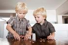 Enrolling children in KiwiSaver can help teach them about saving. Photo / Thinkstock