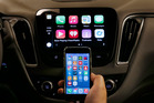 When questioned about the Apple car, the company tries to steer toward its in-car information and entertainment system, CarPlay. Photo / AP