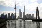 Shanghai business district. Analysts covering the 50 largest companies said equities were set to rally 28 per cent. They weren't anywhere near optimistic enough as shares surged 111 per cent through last week. Photo / Duncan Brown