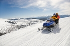 Snowmobiles can take you to some of the most spectacular views on a mountain. Photo / Getty Images