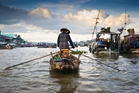 A floating market on the Mekong Delta. Photo / Getty Images