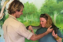 The writer gets to grips with a python at Currumbin Wildlife Sanctuary. Photo / Supplied