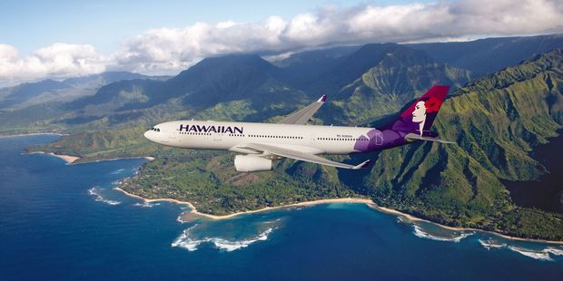 Loading A Hawaiian Airlines Airbus A330 plane over Hawaii.