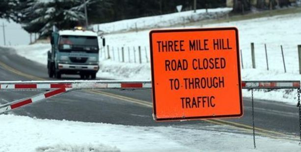 Three Mile Hill Rd was closed to traffic yesterday morning. Photo / Peter McIntosh, ODT