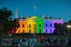 Rainbow lights on the White House marked the Supreme Court decision legalising same-sex marriage. Photo / AP