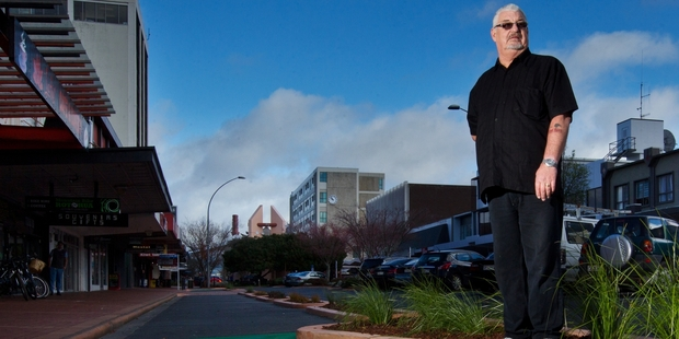 Ross Swenson, owner of Vault Bar and Kiwi Spirit, is angry about the loss of car parks on Hinemoa St due to the Green Corridor project. Photo / Stephen Parker