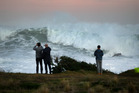 Sightseers watch huge ocean swells between Owhiro Bay and Island Bay, Wellington, last month. Photo / Mark Mitchell