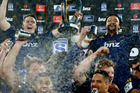 Ben Smith and Nasi Manu lift the Super Rugby trophy. Photo / Getty Images
