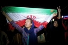 Celebrations in Tehran this week to mark the US-Iran deal ... but elsewhere the two countries are still working against each other. Photo / AP