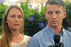 Denise Huskins, left, and her boyfriend Aaron Quinn listen as their attorneys speak at a news conference in Vallejo, California. Photo / AP