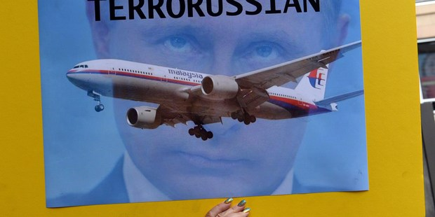 Putin in the frame: Many Ukrainians blame the Russian President for the downing of the flight. Photo / Getty Images