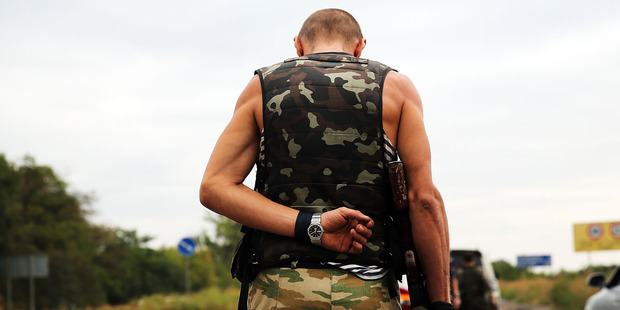 A separatist fighter stands guard in Donetsk, Ukraine. The downing of MH17 fuelled tensions and conflict between separatists and the Ukrainian Government. Photo / Getty Images