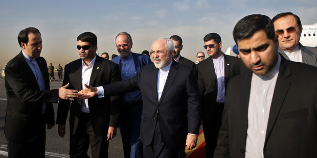 Iran's Foreign Minister Mohammad Javad Zarif (centre) returned to Tehran earlier this week after Iran and the West reached a historic nuclear deal. Photo / AP