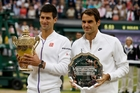 Roger Federer, right, couldn't add to his 17 Grand Slam titles yesterday but remains upbeat despite losing in four sets to now three-time Wimbledon champ Novak  Djokovic. Photo / AP